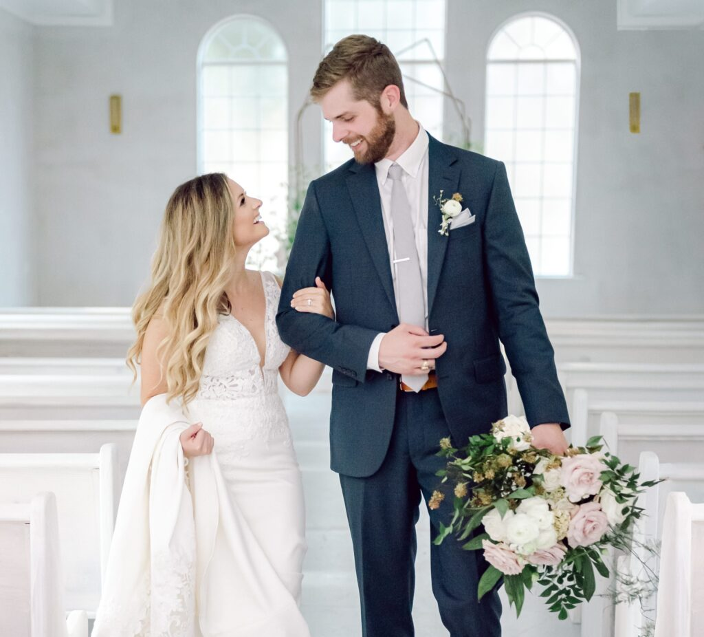 Married Couple in Chapel Aisle